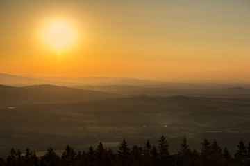 Nice sunset on hills with sun from kravi mountains, Czech landscape