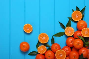 Orange on wooden background.