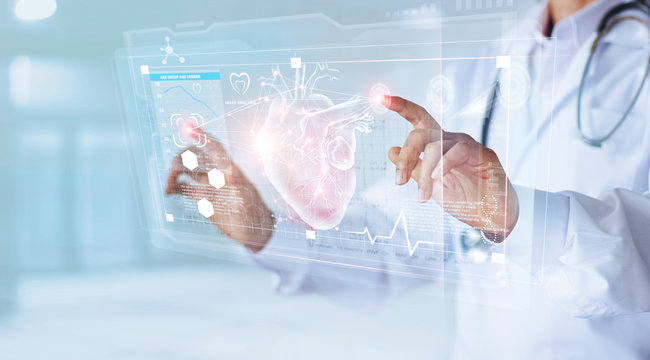 Medicine doctor with stethoscope touching icon heart and diagnostics analysis medical on modern virtual screen interface network connection. Medical technology diagnostics of heart  concept