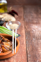 Traditional Asian stir fry chicken wings with sesame and vegetables. Copy