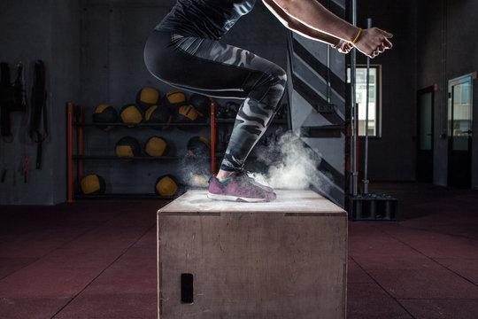Box jump workout at cross fit gym closeup
