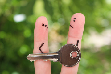 Finger art of family during quarrel. Concept of man and woman can not divide property after divorce.