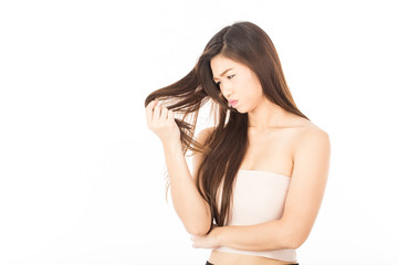 Beautiful Attractive young Asian woman looking in damage dry hairs feeling so sad and worry,Isolated on white background,Haircare Concept