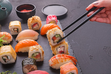 Set of sushi maki and rolls on gray background