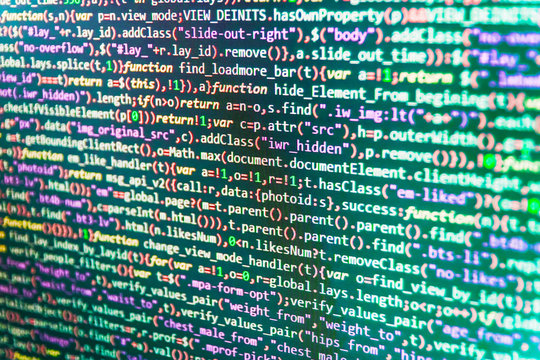 Coding cyberspace concept. IT business company. Abstract technology background. Developer occupation work photo. Writing programming code on laptop. Closeup of Java Script, CSS and HTML code.