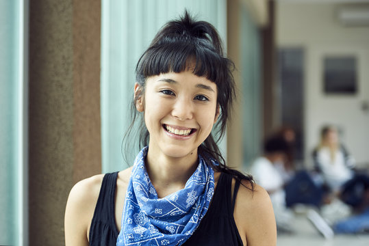 Female college student smiling cheerfully, portrait