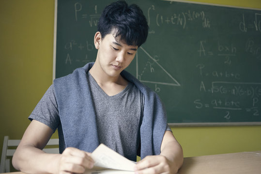 Young man studying in math class