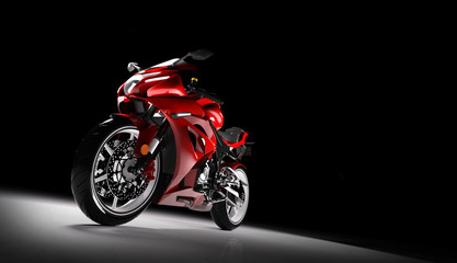 Front view of red sports motorcycle in a spotlight