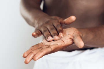 African American man smears hands