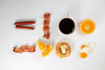 Creative layout - breakfast essentials on white background