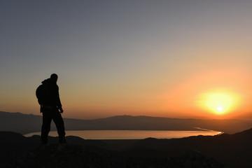 adventurous mountaineer following Sunrise