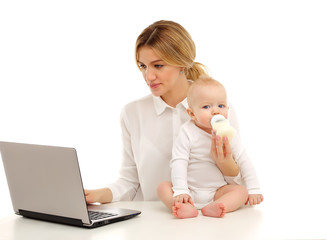 Portrait of a mother and a child working at a computer.