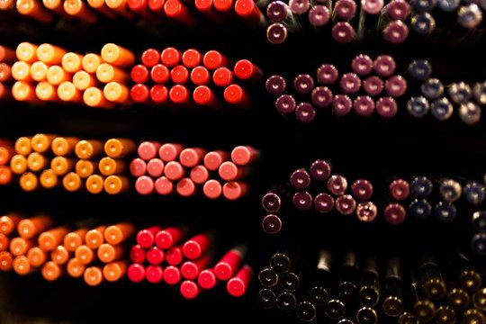 Cosmetic pencils studio photography of make up eye shadow pencils big pallete in shop-window