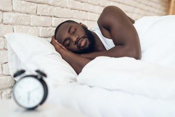 African American man sleeps in bed Wall mural