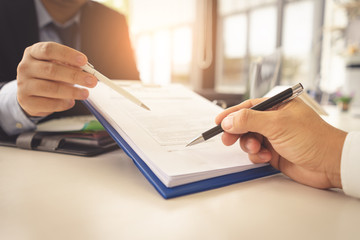 Hands are signing contract agreement.Contract agreement policy concept.
