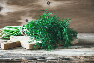 Fresh homegrown dill on rural table