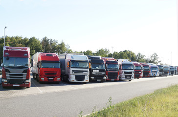 A dozen or so trucks parked at the place of rest