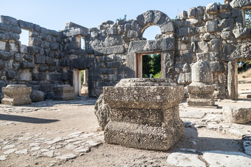 Remains  of columns in the inner hall of the ruins of the Big Sinagogue of the Talmudic Period in Bar'am National Park in Israel.