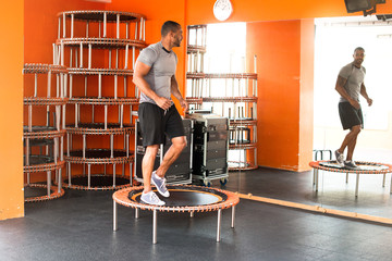 Sport man in the gym making body jump
