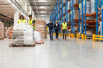 Young quality inspector checking warehouse