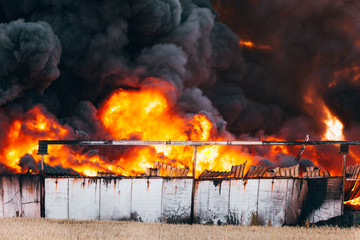 Landfill fire with huge black cloud of smoke