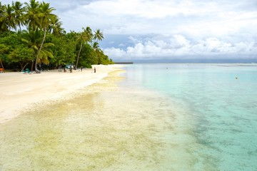 Summer concept , Beach white sand and turquoise sea color at maldives on the weekend holidays