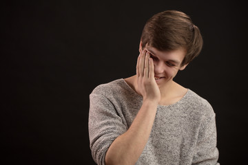close up portrait of young guy laughing to tears isolated on the black background. copyspace