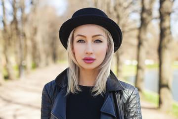 Closeup Female Face. Cute Blonde Woman Outdoors