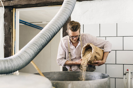 Worker making beer in local brewery