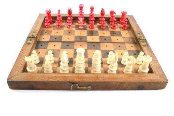 A White and Red Vintage Wooden Chess Set on White Background