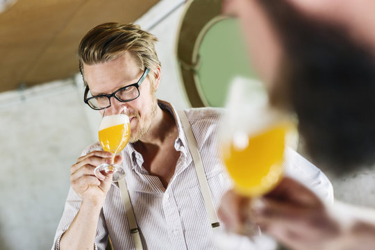 Two men drinking beer in local brewery