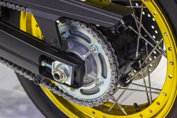 close up detail Motorcycle wheel in black and yellow with ABS brakes part of the motorcycle.