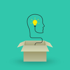 Think outside the box concept with bright lightbulb emerging out of cardboard box. Wire forming face profile outline.