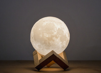 Moon bedside lamp in a wooden stand