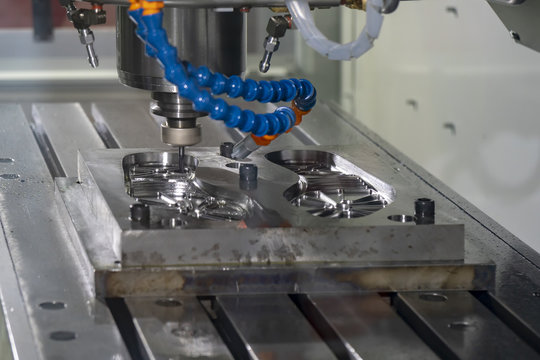 The CNC milling machine cutting the footwear  mold part with the solid ball endmill tool.The Hi-Technology manufacturing process.