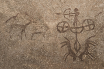 An image of a hunting scene of an ancient man on a cave wall. ancient history, archeology.