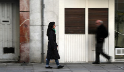 A woman who had an abortion a few years ago walks after an interview with Reuters in Buenos Aires