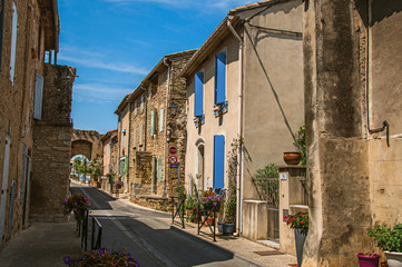 Street view with stone houses in the city center of Chateauneuf-du-Pape hamlet. Near Avignon, Vaucluse department, Provence region, southeastern France.