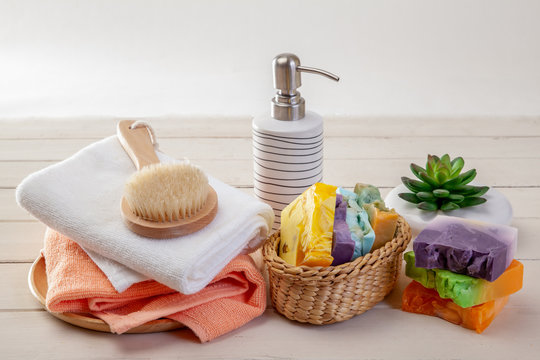 Handmade Soap with bath accessories  on wood background