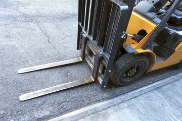 close up of fork lift blades on an urban city street