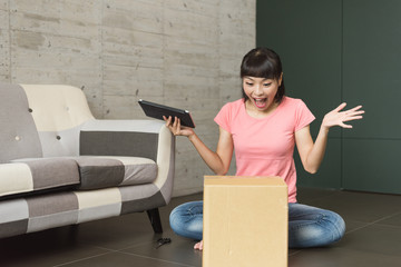 woman unboxing at home