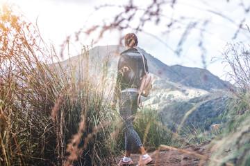 Woman standing on mountain in morning. Bali island.