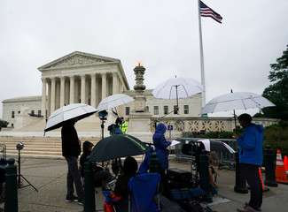 TV news crews await rulings outside the U.S. Supreme Court in Washington
