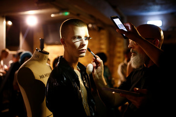 Models prepare backstage of the University of Westminster MA catwalk show at London Fashion Week Men's, in London