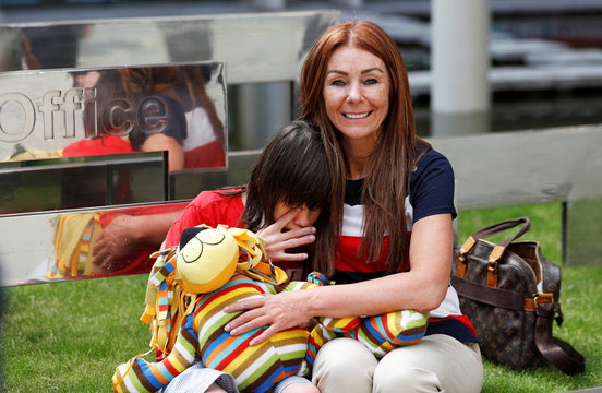 Charlotte Caldwell, and her son Billy, sit outside the Home Office during a break in a meeting with officials to discuss how Billy can have his severe epilepsy treated with cannabis oil, which is a banned substance in Britain, in London