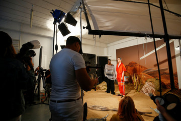 A photoshoot takes place at the Astrid Andersen presentation at London Fashion Week Men's, in London
