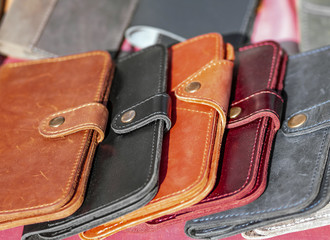 A lot of leather wallets