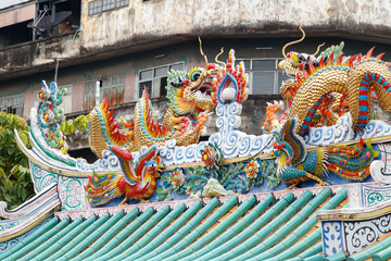 Lee Ti Miew temple Chinese shrines in Bangkok's Chinatown is the Li Thi Miew temple on Plabplachai Road, not far from Wat Kanikaphon. The temple features a large shed-like roof sheltering several shri