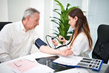 Doctor checking a patient blood pressure