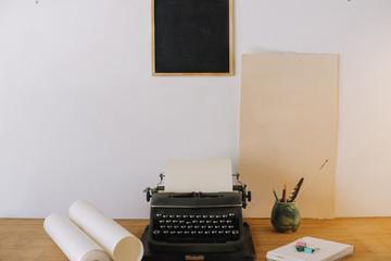Blackboard hanging over typewriter